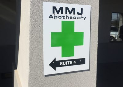 dispensary directional wall sign